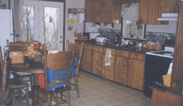 $7000.00 Total Kitchen REDO!, We put in new cabinets, wallpapered over the paneling, added a faux copper tin backsplash and new brushed nickel appliances for $7000.00. Check out the before and after!, Before picture looking out door to what is now our dining room.        , Kitchens Design
