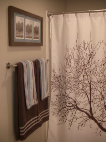 "$450 bathroom update Before/After, This is my hall bath redo. I was inspired by another ratemyspacer who told me where to get the shower curtain she had in her space. I love the results for a total of $450 bucks!, I took a picture of my ""mothers day tree"" and printed it in sepia. I tripled it...and framed it. I like it! , Bathrooms Design"