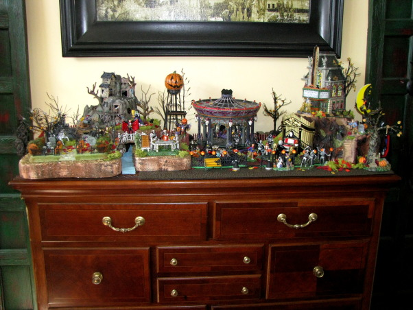 "Halloween by Michelle, Halloween, for me, is about magic and whimsy.  I like decorating with a ""Yester-year"" style, using little witches and black cats,  paper mache pumpkin heads and crate paper ruffles.  My haunt, inside and out, is ""little kid friendly"" and I won't put anything up that will scare them.     , Halloween town.. I guess I'm out of room.            , Holidays Design"