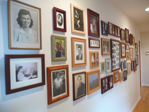 Family Photo Gallery, My entry hall was bland and boring until I hung a collection of family photos., On the back of each frame are names and dates so they won't be lost over time., Living Rooms Design