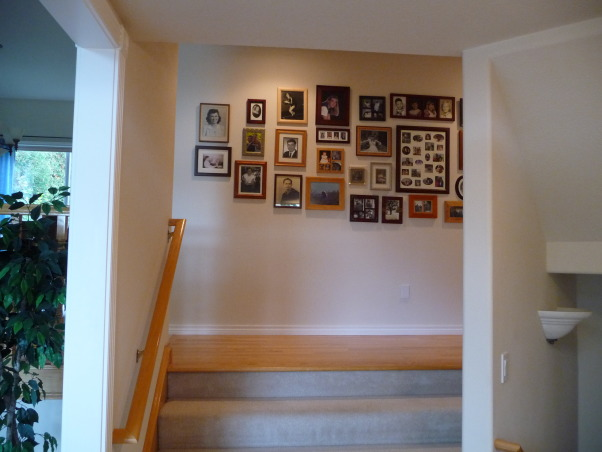 Family Photo Gallery, My entry hall was bland and boring until I hung a collection of family photos., The pictures seem to draw people in and up the stairs to the main living area.  Often there are conversations about the pictures., Living Rooms Design