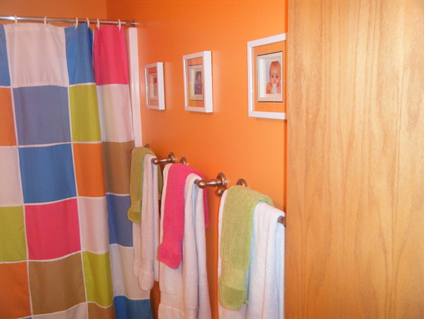 "Tropical Kids, My 3 kids (2 boys & 1 girl) share a hall bath so I wanted to decorate it ""gender neutral""...bright colors with Hawaii/surf accents were the solution., Since there was 3 kids sharing this bathroom I had towel bars cut to size so I could have 3 on the wall.  Above the towels are pics of the kids as babies.  I used white towel to off set the bright wall color. , Bathrooms Design"