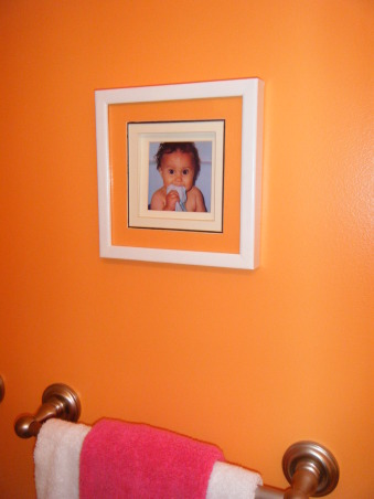 "Tropical Kids, My 3 kids (2 boys & 1 girl) share a hall bath so I wanted to decorate it ""gender neutral""...bright colors with Hawaii/surf accents were the solution., Picture of my daughter above her towel. , Bathrooms Design"