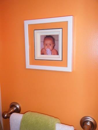 "Tropical Kids, My 3 kids (2 boys & 1 girl) share a hall bath so I wanted to decorate it ""gender neutral""...bright colors with Hawaii/surf accents were the solution., Picture of my oldest son above his towel. , Bathrooms Design"