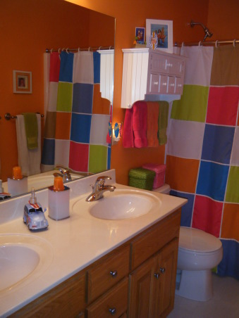 "Tropical Kids, My 3 kids (2 boys & 1 girl) share a hall bath so I wanted to decorate it ""gender neutral""...bright colors with Hawaii/surf accents were the solution., Look into from the hall.  Woody truck is a soap dispenser and the wall unit holds all my daughters ""girly"" hair accessories. , Bathrooms Design"