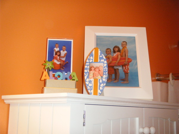 "Tropical Kids, My 3 kids (2 boys & 1 girl) share a hall bath so I wanted to decorate it ""gender neutral""...bright colors with Hawaii/surf accents were the solution., Had these taken of the kids about a year before I re-did the bathroom.  They were the perfect accent. , Bathrooms Design"