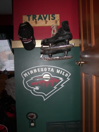 MN Wild Hockey, Living the game. My son grew up watching HGTV with me and has his own knack for decorating.  He designed the headboard, My husband built it and I painted.  It was a family effort., I hand painted the Minnesota Wild Logo on the wall and hung a very old set of skates. , Boys' Rooms Design