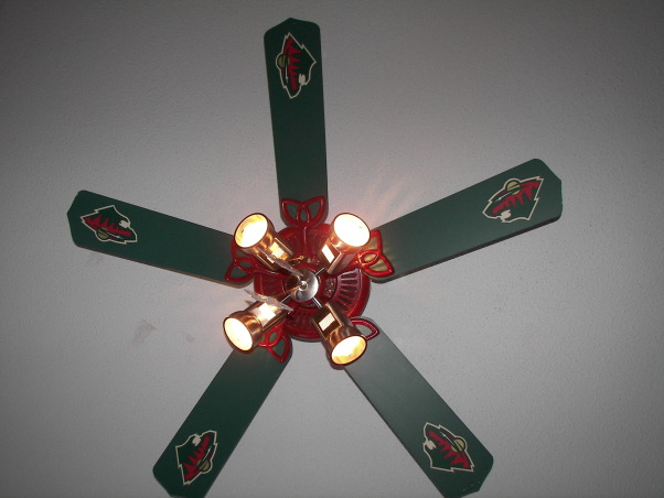 MN Wild Hockey, Living the game. My son grew up watching HGTV with me and has his own knack for decorating.  He designed the headboard, My husband built it and I painted.  It was a family effort., My husband took an old white fan out of a restoraunt remodel job and we cleaned it up, painted it, bought a new light kit and cut out the wild logo from wall paper boarder., Boys' Rooms Design