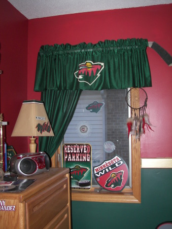 MN Wild Hockey, Living the game. My son grew up watching HGTV with me and has his own knack for decorating.  He designed the headboard, My husband built it and I painted.  It was a family effort., I cut out more MN Wild wallpaper boarder to decorate the lamp shade and used an old hockey stick for the curtain rod., Boys' Rooms Design