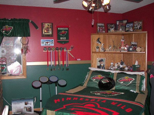 MN Wild Hockey, Living the game. My son grew up watching HGTV with me and has his own knack for decorating.  He designed the headboard, My husband built it and I painted.  It was a family effort., My son insisted on putting his double bed intot he corner.  He designed the headboard for my husband and my husband built it., Boys' Rooms Design