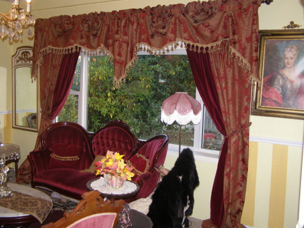 Victorian Living Room, I looked for the perfect drapes in antique malls and auctions, but I found these at JCPenny's and the price was right, I just love them.  I added the velvet panels for depth.  It was hard finding drapes to fit this big picture window.   , Living Rooms Design