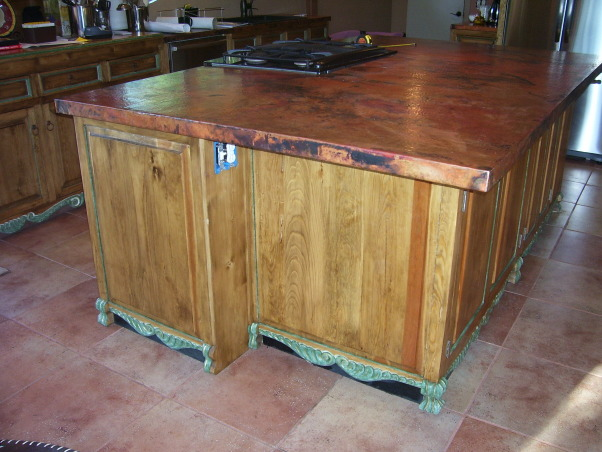 KITCHEN REMODEL GONE BAD!, I NEED HELP.. WE REMODELED OUR KITCHEN AND I HATE IT.. IT WAS DONE BY DESIGNERS THAT BOTCHED IT UP AND WILL NOT FIX THE MISTAKES.. AND YES WE ARE IN COURT!!! I WANTED THE HUTCH TO LOOK LIKE A PIECE OF FURNITURE AND GOT THAT UGLY THING!!!.. I HAVE 2 DIFFERENT COUNTERTOPS.. LOVE THE HAMMERED COPPER BUT HATE THE WOOD!! ANYONE WITH IDEAS HOW TO TIE THE COPPER AND REPLACE THE WOOD WITH SOMETHING SO THAT IT WORKS TOGETHER WITHOUT REPLACING THE EXPENSIVE COPPER??? THX I KNOW THIS IS A CHALLENGE!! I AM LOST FOR IDEAS AND WE ARE OUT OF MONEY!!!, KITCHEN ISLAND IS ALL IN COPPER.. , Kitchens Design