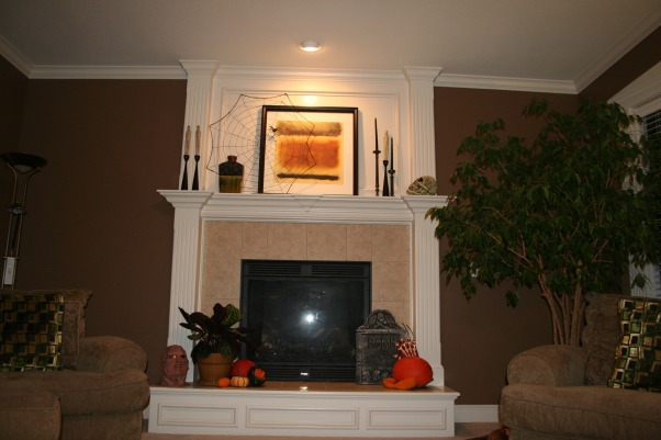 Halloween Fireplace, Here is my gas fireplace all decorated for halloween, I love the giant spider webs and using real pumpkins and gourds., Fireplace up close in my living room.   , Living Rooms Design