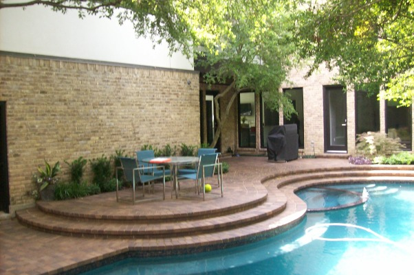 Dallas Modern, My client was unhappy with the pool that they inherited in this backyard when they purchased the property.  Our solution was to wipe the slate clean, and start over.  What I developed for them was a very clean, stream-lined appearance to the pool area with Leuder Limestone coping, and a sawcut, colored concrete decking that perfectly matches the appearance of the stone.  The yard is very long and narrow, so rather than having a typical fence that follows the property lines, I incorporated a curved stucco wall in the back corner, and painted it a vibrant green, in order to draw the energy back into the space.  A preserved bamboo sculpture, and 14' long arc of fire grace this curved wall and create fantastic shadow movement in the evening light., Before #2    , Pools Design