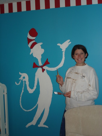 The Cat in the Hat Nursery, After visiting Universal studios 4 months pregnant and only being able to ride the kiddie rides, I was inspired by the Dr. Suess rides to create a Suess Nursery., Me starting to paint the Cat in the Hat on another wall., Nurseries Design