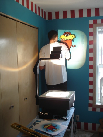 The Cat in the Hat Nursery, After visiting Universal studios 4 months pregnant and only being able to ride the kiddie rides, I was inspired by the Dr. Suess rides to create a Suess Nursery., Painting the Lorax on one wall., Nurseries Design