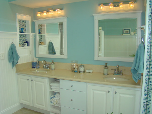 Master Bathroom Remodel, Sophisticated, contemporary Master Bathroom with a little bit of sparkle! The focal point is the shower with blue mosiac tile and a new glass door enclosure. Wanescoting and teal walls add to the beach feel. And new sand countertops speak to the new tan tile floor.  A separate vanity area and private corner finish off this Master Bath. Heavenly and a dream come true!, Double sinks with plenty of storage including drawers, cabinetry and shelves for displaying towels.    , Bathrooms Design