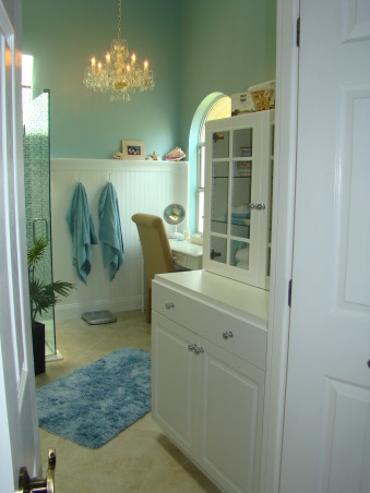 Master Bathroom Remodel, Sophisticated, contemporary Master Bathroom with a little bit of sparkle! The focal point is the shower with blue mosiac tile and a new glass door enclosure. Wanescoting and teal walls add to the beach feel. And new sand countertops speak to the new tan tile floor.  A separate vanity area and private corner finish off this Master Bath. Heavenly and a dream come true!, New double doors open out to reveal storage on the right. Teal walls above wanescoting set the stage for a chandellier near the vanity area.     , Bathrooms Design
