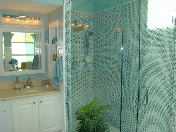 Master Bathroom Remodel, Sophisticated, contemporary Master Bathroom with a little bit of sparkle! The focal point is the shower with blue mosiac tile and a new glass door enclosure. Wanescoting and teal walls add to the beach feel. And new sand countertops speak to the new tan tile floor.  A separate vanity area and private corner finish off this Master Bath. Heavenly and a dream come true!, Shower with blue mosaic tile and glass doors.  , Bathrooms Design