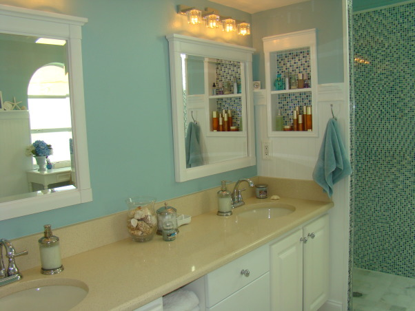 "Master Bathroom Remodel, Sophisticated, contemporary Master Bathroom with a little bit of sparkle! The focal point is the shower with blue mosiac tile and a new glass door enclosure. Wanescoting and teal walls add to the beach feel. And new sand countertops speak to the new tan tile floor.  A separate vanity area and private corner finish off this Master Bath. Heavenly and a dream come true!, Sand ""zodiac"" countertops. New contemporary lighting adds warmth and  built in shelving with mosiac tile accent make it practical.     , Bathrooms Design"