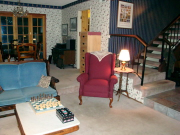 english cottage look, living room/music studio. This is where I teach violin.  The Ethan Allen love seats were given to me by my parents as hand me downs, and I never got around to replacing them. The wall paper was my attempt at coordinating with the rather plain looking love seats, and creating kind of an English cottage look.  I might be ready for a complete makeover.  The pink carpet is stained and needs to go., I like hand crafts and crocheted the doilies.  Not the most modern look, I know., Living Rooms Design