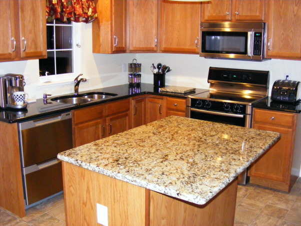 Help me decorate my kitchen, I recently remodeled my kitchen by adding granite countertops and stainless steel appliances. My colors are mostly black, beige, gray, white and a bit of gold in my island granite. My walls are a pale cream. I have no clue what curtains to use for above my sink and then also I have a sliding glass door that I don't know what to do with. I was thinking maybe a black valance above the sink on a ss pole with the clips that hang down to attach the curtain and maybe 3 panels on the slider. I don't want it to be to blah but I can't figure out any color that will look good. I need decorating tips also to add some pizazz to my new kitchen. Please give me your suggestions., Another shot of the window with my current curtain. It's country and I want more modern. Give me suggestions please, Kitchens Design