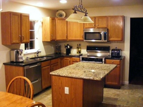 Help me decorate my kitchen, I recently remodeled my kitchen by adding granite countertops and stainless steel appliances. My colors are mostly black, beige, gray, white and a bit of gold in my island granite. My walls are a pale cream. I have no clue what curtains to use for above my sink and then also I have a sliding glass door that I don't know what to do with. I was thinking maybe a black valance above the sink on a ss pole with the clips that hang down to attach the curtain and maybe 3 panels on the slider. I don't want it to be to blah but I can't figure out any color that will look good. I need decorating tips also to add some pizazz to my new kitchen. Please give me your suggestions., Here is a pic of my window over the sink that I need curtain ideas for color and style. I was thinking black but not sure if this is too much black. There is also a sliding glass door to the far left that needs a curtain also., Kitchens Design
