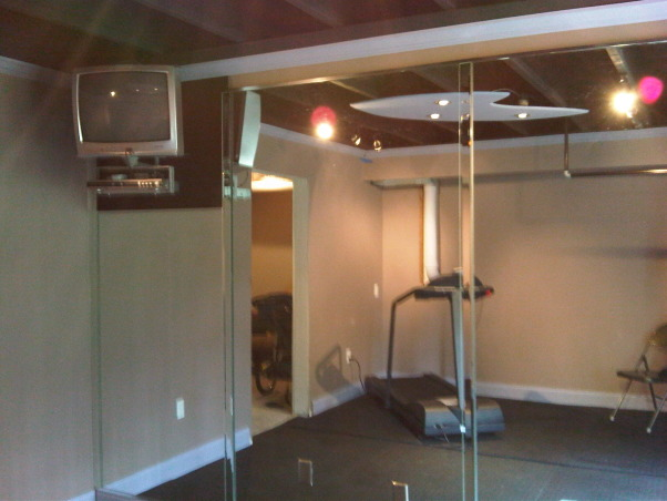 home gym, This is the second room finished out in the basement. this P90x inspired room has a mirrored wall and rubber flooring, Other Spaces Design