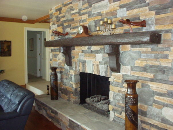 manly room, Combined Living room and dining room.  Space is 25' long by 20' wide. Hardwood floors, beam ceiling and stone fireplace , The new fireplace is man made stone, with a mantel from an old cotton mill floor joist  , Living Rooms Design