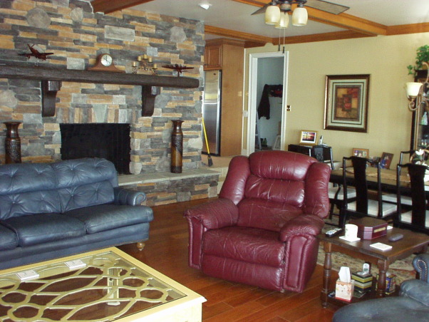 manly room, Combined Living room and dining room.  Space is 25' long by 20' wide. Hardwood floors, beam ceiling and stone fireplace , Final view of room   , Living Rooms Design