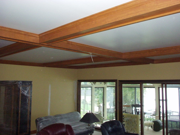 manly room, Combined Living room and dining room.  Space is 25' long by 20' wide. Hardwood floors, beam ceiling and stone fireplace , beam ceiling added after sheet rock to cover over the old popcorn ceiling   , Living Rooms Design