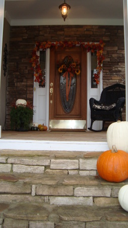 My Porch in the Fall, This is my front porch in the Fall.  I flanked the front door with fall foliage, pumpkins and gourds.  I even added some pumpkins to my ivy baskets on the porch railings.  Now all that is needed is some hot apple cider and the smell of leaves burning., Porches Design