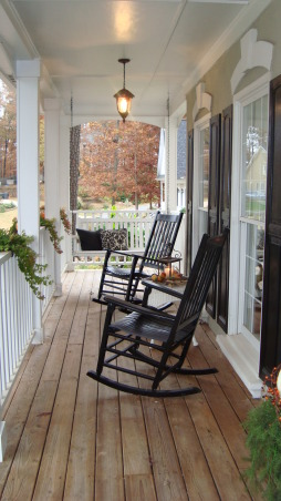 My Porch in the Fall, This is my front porch in the Fall.  I flanked the front door with fall foliage, pumpkins and gourds.  I even added some pumpkins to my ivy baskets on the porch railings.  Now all that is needed is some hot apple cider and the smell of leaves burning., Oops!  I need to add a throw for warmth out here.  I'll have to go inside and get one.    , Porches Design
