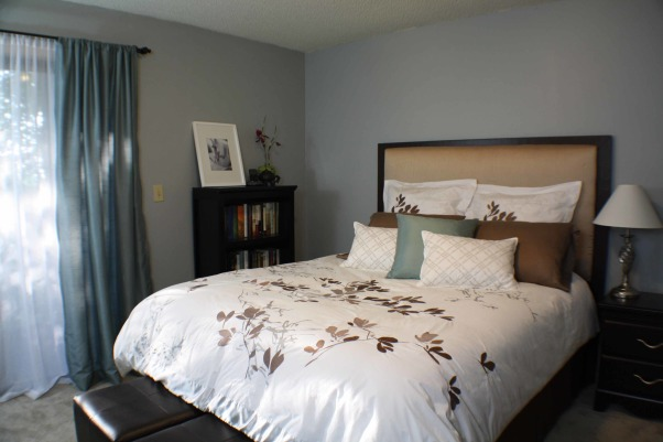 "Homemade Headboard, This is the bedroom at my last apartment. The comforter is from Bed, Bath and Beyond and pretty much everything else is from Target. I made the headboard myself with 2x6 wood, foam batting and material from a clearance drapery panel at Marshall's. The wall color is Valspar's ""Polished Silver"", The headboard was built with legs and just propped up between the bed and the wall       , Bedrooms Design"