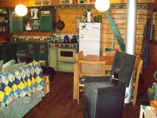Small Alaskan Cabin, A small rustic Alaskan cabin in the wild woods.  Three sided log 16x20 cabin with half loft., This is our small eating area in front is our drip oil stove that heats our small cabin.  , Kitchens Design