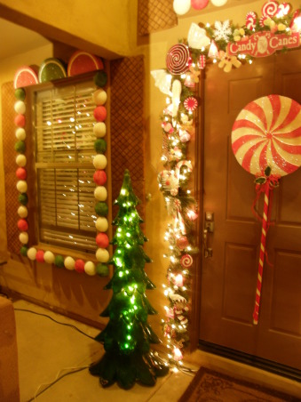 Gingerbread House, We decorated the outside of our house to look like a gingerbread house. , My house made into a gingerbread house. Windows made out of gumballs, Wafer cookies and lemon Wedges.  , Holidays Design
