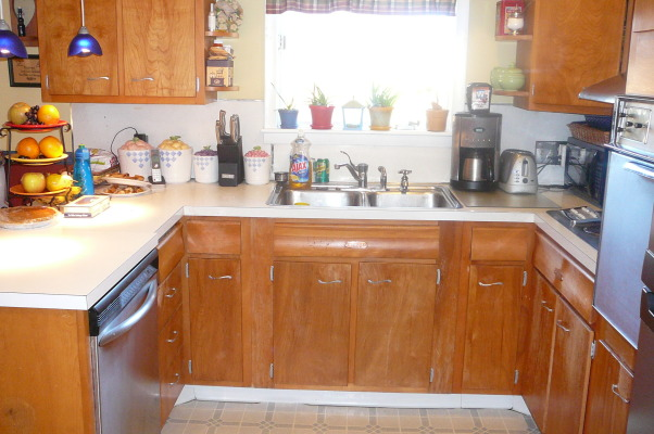 "1959 Kitchen Gets Makeover with White Painted Cabinets!, We did a mini makeover our 1959 kitchen with old worn cabinets and the classic white formica with gold flecks. It cost us less than $3000 to do this and a little more than half of that cost was for the new countertops, rest was for new sink, cooktop, paint, primer and various supplies.   How we did it: We sanded all cabinet bases, doors and drawers and primered with Zinnser BIN primer (THE BEST!) and 2-3 coats of ""piano key"" white Valspar semi-gloss brushed on with a good 2.5"" brush (don't try spraying it was a disaster!). New GE stainless cooktop and ACE stainless sink, new subway tile backsplash. All hardware stripped down to steel base, and clear-coated with Rustoleum. We will be putting in a new floor either continuing the oak hardwood into the kitchen or putting in slate. The Formica is black slate in the ""honed"" finish. It looks and feels like slate and has slight white grain running through it. Nearly indestructible and 1/10 the price of granite!! , Before picture         , Kitchens Design"