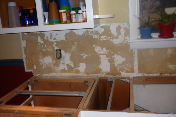 "1959 Kitchen Gets Makeover with White Painted Cabinets!, We did a mini makeover our 1959 kitchen with old worn cabinets and the classic white formica with gold flecks. It cost us less than $3000 to do this and a little more than half of that cost was for the new countertops, rest was for new sink, cooktop, paint, primer and various supplies.   How we did it: We sanded all cabinet bases, doors and drawers and primered with Zinnser BIN primer (THE BEST!) and 2-3 coats of ""piano key"" white Valspar semi-gloss brushed on with a good 2.5"" brush (don't try spraying it was a disaster!). New GE stainless cooktop and ACE stainless sink, new subway tile backsplash. All hardware stripped down to steel base, and clear-coated with Rustoleum. We will be putting in a new floor either continuing the oak hardwood into the kitchen or putting in slate. The Formica is black slate in the ""honed"" finish. It looks and feels like slate and has slight white grain running through it. Nearly indestructible and 1/10 the price of granite!! , under the formica backsplash.... a mess of glue from 1959. how do you get this glue off the backsplash... blow torch. I kid you not. Blow torch and scrape and the walls were perfect!          , Kitchens Design"