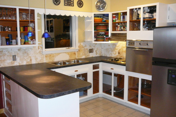 "1959 Kitchen Gets Makeover with White Painted Cabinets!, We did a mini makeover our 1959 kitchen with old worn cabinets and the classic white formica with gold flecks. It cost us less than $3000 to do this and a little more than half of that cost was for the new countertops, rest was for new sink, cooktop, paint, primer and various supplies.   How we did it: We sanded all cabinet bases, doors and drawers and primered with Zinnser BIN primer (THE BEST!) and 2-3 coats of ""piano key"" white Valspar semi-gloss brushed on with a good 2.5"" brush (don't try spraying it was a disaster!). New GE stainless cooktop and ACE stainless sink, new subway tile backsplash. All hardware stripped down to steel base, and clear-coated with Rustoleum. We will be putting in a new floor either continuing the oak hardwood into the kitchen or putting in slate. The Formica is black slate in the ""honed"" finish. It looks and feels like slate and has slight white grain running through it. Nearly indestructible and 1/10 the price of granite!! , Countertops are in          , Kitchens Design"