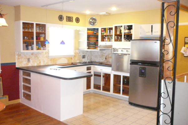 "1959 Kitchen Gets Makeover with White Painted Cabinets!, We did a mini makeover our 1959 kitchen with old worn cabinets and the classic white formica with gold flecks. It cost us less than $3000 to do this and a little more than half of that cost was for the new countertops, rest was for new sink, cooktop, paint, primer and various supplies.   How we did it: We sanded all cabinet bases, doors and drawers and primered with Zinnser BIN primer (THE BEST!) and 2-3 coats of ""piano key"" white Valspar semi-gloss brushed on with a good 2.5"" brush (don't try spraying it was a disaster!). New GE stainless cooktop and ACE stainless sink, new subway tile backsplash. All hardware stripped down to steel base, and clear-coated with Rustoleum. We will be putting in a new floor either continuing the oak hardwood into the kitchen or putting in slate. The Formica is black slate in the ""honed"" finish. It looks and feels like slate and has slight white grain running through it. Nearly indestructible and 1/10 the price of granite!! , Kitchens Design"