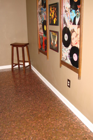 """Penny Floor"" game room, 52,000 pennies used for our game room floor.Custom bar with early 1900's woodwork. Cozy fireplace surrounded in slate tile with a solid oak mantel. , Old album covers surrounded by an antique divider frame. Flooring is our fabulous 52,000 penny floor., Basements Design"