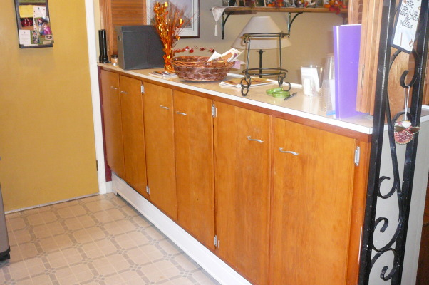 "1959 Kitchen Gets Makeover with White Painted Cabinets!, We did a mini makeover our 1959 kitchen with old worn cabinets and the classic white formica with gold flecks. It cost us less than $3000 to do this and a little more than half of that cost was for the new countertops, rest was for new sink, cooktop, paint, primer and various supplies.   How we did it: We sanded all cabinet bases, doors and drawers and primered with Zinnser BIN primer (THE BEST!) and 2-3 coats of ""piano key"" white Valspar semi-gloss brushed on with a good 2.5"" brush (don't try spraying it was a disaster!). New GE stainless cooktop and ACE stainless sink, new subway tile backsplash. All hardware stripped down to steel base, and clear-coated with Rustoleum. We will be putting in a new floor either continuing the oak hardwood into the kitchen or putting in slate. The Formica is black slate in the ""honed"" finish. It looks and feels like slate and has slight white grain running through it. Nearly indestructible and 1/10 the price of granite!! , Before pic, pantry cabinets  , Kitchens Design"