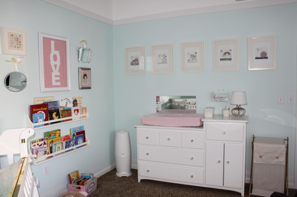 "Playful with Personality, The design for the nursery was inspired by my ""vision"" of what my future daughter might be like. While I had originally planned a very girly pink, brown and cream nursery with lots of frilly details, I changed that plan when I envisioned a very laid-back girl, full of personality and with a style all her own. I wanted the room to feel serene and relaxing while still exuding an element of fun and playfulness. I knew I didn't want it to feel ""matchy matchy"" or straight from a box, but rather be sprinkled with elements that had personal meaning or importance. The nursery has been a work in progress and has grown over time, as we moved into the house the DAY BEFORE I went into labor! , Nurseries Design"