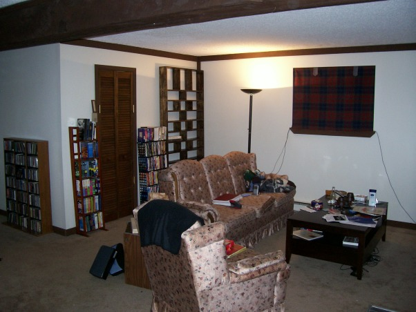 Our Awkward Layout Living Room, We're trying to arrange this rather awkward space, but it's tricky., This is the view with out stuff.  I built the media shelf on the wall.  It holds all of our CD's. But, again, this room needs advice. , Living Rooms Design