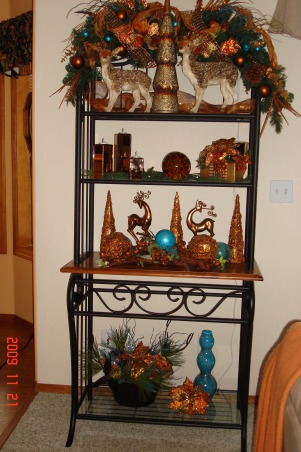 Christmas Home Tour, winter wonderland in master bath, This is our bakers rack in the familyroom. We had a raindeer theme in this room.  Colors used are copper and blue., Holidays Design