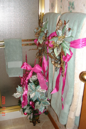 Christmas Home Tour, winter wonderland in master bath, This is our guest bathroom downstairs. These are the towels in tan and aqua with hot pink ribbons.  A small christmas tree sits of the floor., Holidays Design