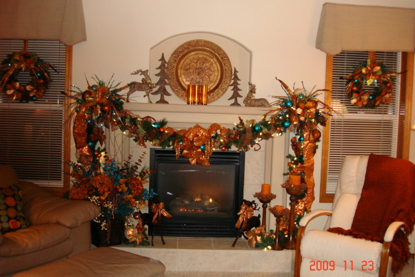 Christmas Home Tour, winter wonderland in master bath, This is our family room fire place.  I used copper, orange and blue colors , Holidays Design