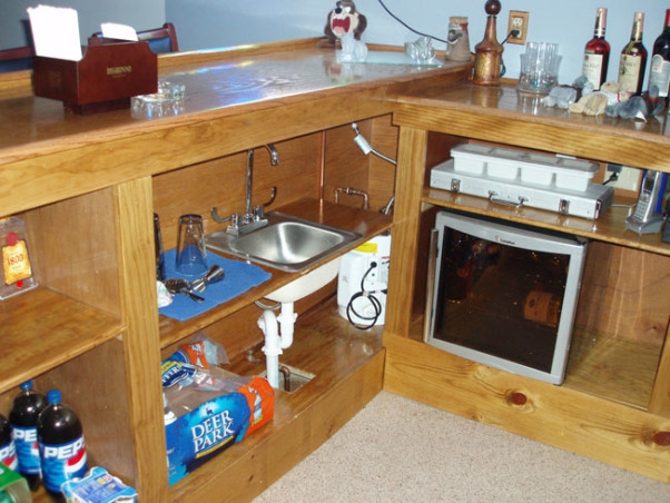 Man Cave, Custom Bar and Entertainment Center, Stainless steel sink with hot and cold water.  Small hot water tank next to sink and a wine cooler., Basements Design