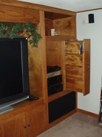 Man Cave, Custom Bar and Entertainment Center, Custom Entertainment Center with custom dvd holders, Basements Design