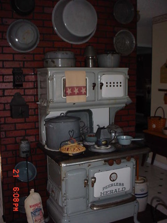 My Primitive/Country Kitchen, My old graniteware stove is still sitting in the garage.  I never have moved it back after I has the kitchen floored installed. , Kitchens Design